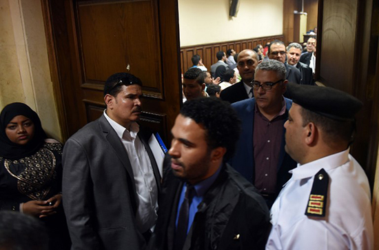Human rights defender Gamal Eid (second from right) leaves a Cairo courtroom on April 20, 2016. (AFP)