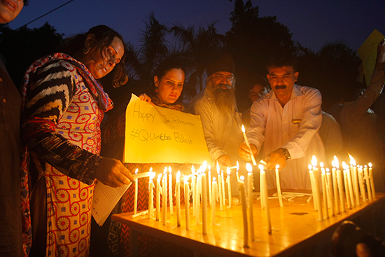 Civil society activists in Peshawar pay tribute to the victims of a bomb attack on mourners at a hospital in Quetta, August 8, 2016. At least two journalists were killed in the blast. (AP/Mohammad Sajjad)