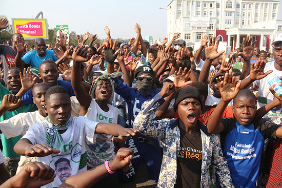 Supporters of Edgar Lungu in Lusaka cheer Zambia's electoral commission's announcement that he had narrowly won August 11 presidential elections, August 15, 2016. (Reuters)