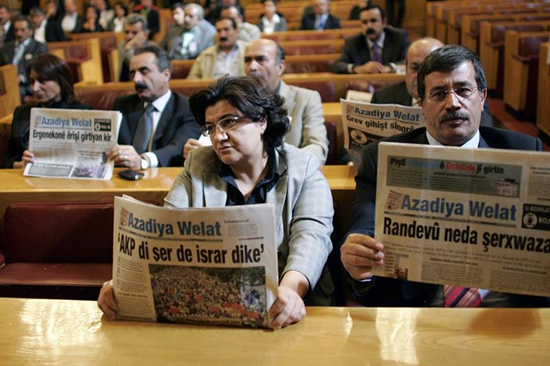 In this October 2008 file photo, opposition lawmakers hold copies of Azadiya Welat newspaper during a meeting of the parliament to protest a month-long ban on the publication. (Umit Bektas/Reuters)