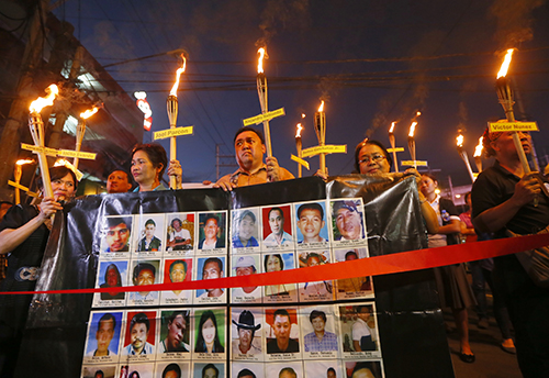 Relatives of the journalists killed in the Maguindanao massacre hold a vigil in 2015. A new task force has been set up to investigate press killings. (AP/Bullit Marquez)