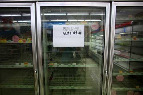 An empty refrigerator at a convenience store at West Lake, in Hangzhou, China, on August 31 bears a sign that reads 'During G20, beverages and dairy products are not allowed to be purchased and are sold out. Thanks.' Authorities have ordered the media not to report on inconveniences caused by the summit. (Reuters/Aly Song)