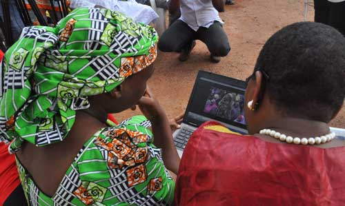 Esther Yakubu, left, mother of one of hundreds of kidnapped school girls, watches a video released by Boko Haram during a briefing in Abuja, Nigeria, on August 14, 2016. A military spokesman threatened journalist Ahmad Salkida with terrorism charges if he does not provide information he gained in the course of reporting on the militant group. (AP Photo/Olamikan Gbemiga)