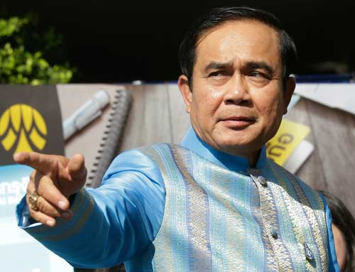 Thai Prime Minister Prayuth Chan-ocha arrives for a cabinet meeting in Bangkok on August 9, 2016. He has empowered a state media regulator to close news outlets without the right to appeal for reasons of national security. (AP/Sakchai Lalit)