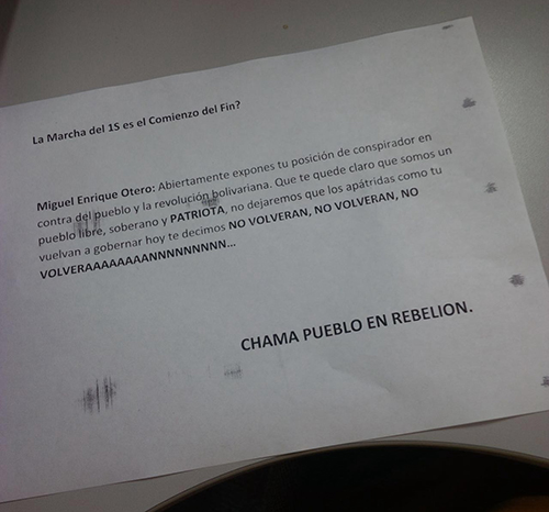 A threatening note, pictured, from a pro-government group was left outside the vandalized offices of El Nacional. (El Nacional)