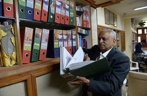 Subhash Agrawal looks through files at his office in Delhi. The activist has used the Right to Information Act to expose cases of wrongdoing. (AFP/Sajjad Hussain)