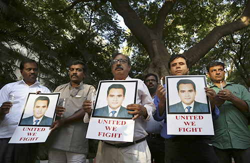 A vigil for Akshay Singh. His channel joined initial calls for an independent investigation into his death. (AP/Aijaz Rahi)