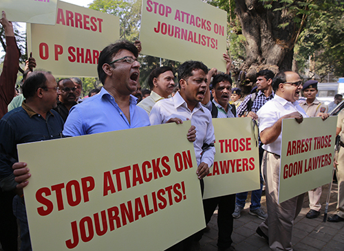 In a rare show of solidarity, journalists march together in protest after lawyers attacked members of the press outside a Delhi court house in February 2016. (AP/Rafiq Maqbool)