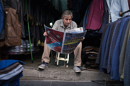 In this July 21, 2016, file photo, a merchant reads the newspaper in Istanbul. (AP/Petros Giannakouris)