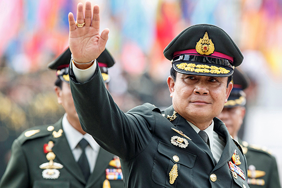 In this September 30, 2014, file photo, Thai Prime Minister Prayut Chan-o-cha waves after a Bangkok handover ceremony for the new chief of the Royal Thai Army. (Reuters/Athit Perawongmetha)