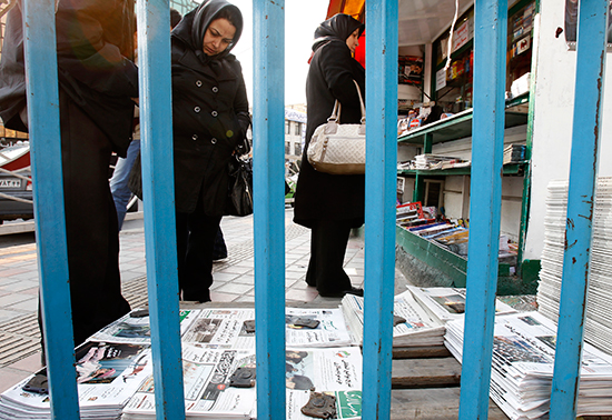Residents of Tehran read the front pages of newspapers in this December 4, 2011, file photo. (Reuters/Raheb Homavandi)