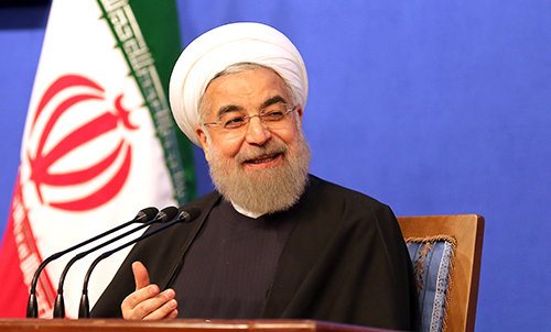 President Hassan Rouhani, pictured at a press conference in March 2016, has submitted a draft bill to parliament that proposes creating a state-regulated organization to oversee the country's press. (AFP/Atta Kenare)