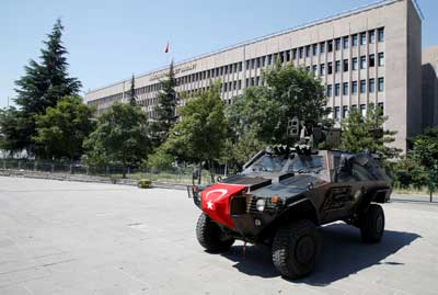 Members of police special forces keep watch from an armored vehicle in front of a courthouse in Ankara, Turkey, on July 18, 2016. (Reuters/Baz Ratner)