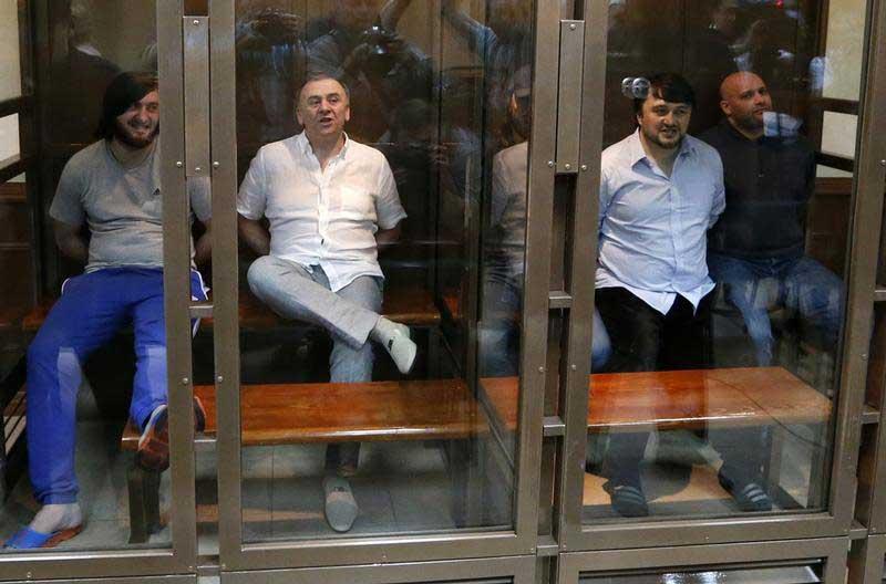 Defendants await sentencing in the murder trial of Russian journalist Anna Politkovskaya. No mastermind has been identified in her killing 10 years ago. (Reuters/Sergei Karpukhin)