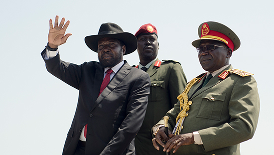 South Sudanese President Salva Kiir, shown on the left in this September 12, 2016, file photo, has severely cracked down on the country's news media. (AP/Jason Patinkin)