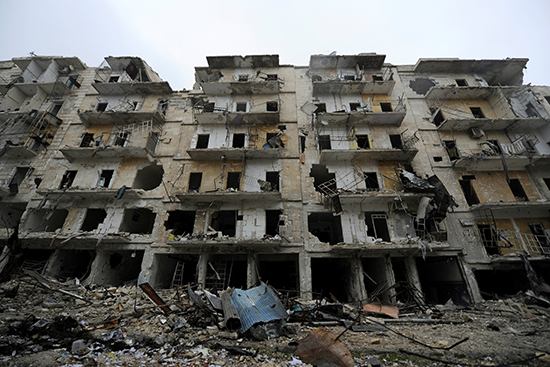 Damaged buildings are seen in the government-held Aleppo neighborhood of Al-Shaath during a media tour, December 13, 2016. (Reuters/Omar Sanadiki)