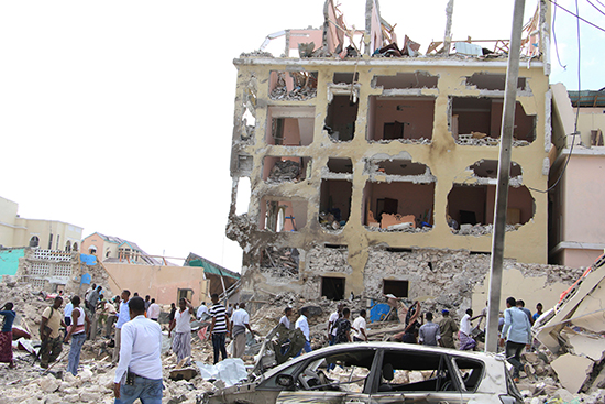 Somalis gather at the site of a Mogadishu hotel badly damaged in a lethal attack on January 25, 2017. (AP/Farah Abdi Warsameh)