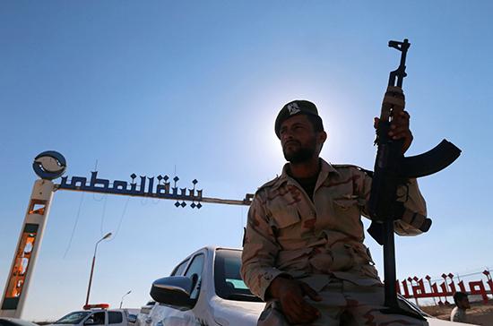 A soldier loyal to Field Marshal Khalifa Belqasim Haftar sits outside the Zueitina oil terminal, west of Benghazi, Libya, September 15, 2016. (Reuters/Esam Omran Al-Fetori)