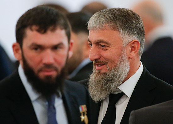 Magomed Daudov (left), the speaker of the Chechen parliament, waits for Russian President Vladimir Putin to deliver the annual state of the nation address at the Kremlin in Moscow, December 1, 2016. Daudov on January 4 threatened journalist Grigory Shvedov in a post to Instagram. (Reuters/Maxim Shemetov)