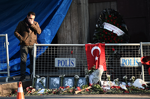 Tributes are left to victims of a terror attack at an Istanbul nightclub. Turkey has ordered a news ban over coverage of the incident. (AFP/Ozan Kose)