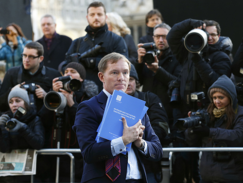 Labour MP Chris Bryant holds copies of the Leveson Report into press ethics in 2012, which led to the creation of Section 40 of the Crime and Courts Act. A consultation on enacting the restrictive legislation, which came about as a result of the inquiry, ends January 10. (AFP/Justin Tallis)
