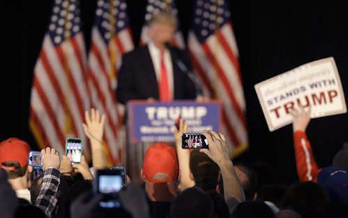 Crowds record Donald Trump on their phones during a rally in April. Journalists say they have been targeted by online trolls for their coverage of Trump. (AP/Steven Senne)