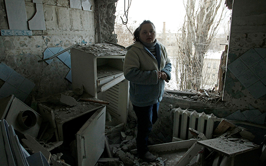 A woman stands in the rubble of her apartment, which was damaged by shelling, in the eastern Ukrainian city of Donetsk, February 1, 2017. (Reuters/Alexander Ermochenko)