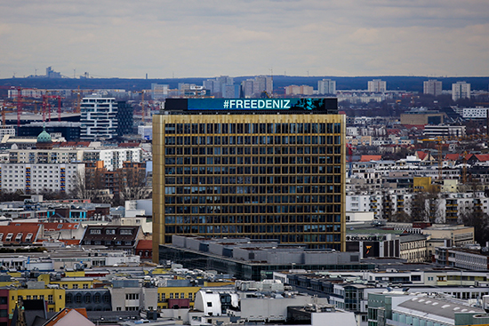 """Free Deniz"" is written across the Berlin headquarters of publisher Axel Springer Markus Schreiber, February 28, 2017. (AP/Markus Schreiber)"