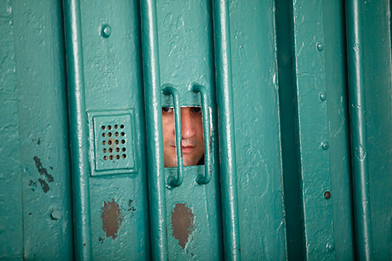 A guard looks through a small window in Algiers' El Harrach Prison, July 14, 2010. (Reuters/Louafi Larbi)