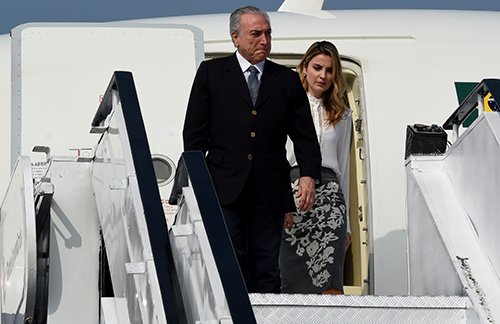 Brazil's President Michel Temer and his wife, Marcela, pictured in October 2016. Two papers were ordered to remove reports on the trial of a hacker who targeted the first lady. (AFP/Money Sharma)