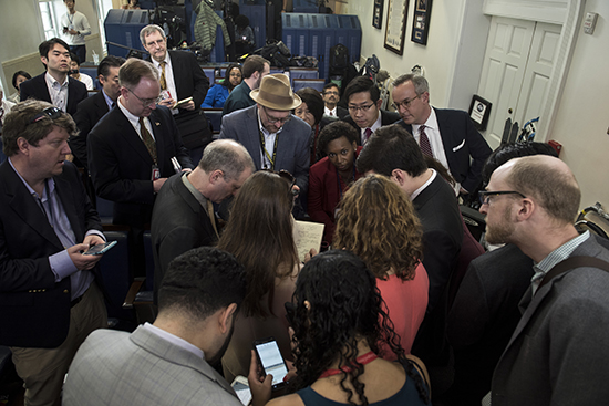 Reporters gather after being denied access to an informal White House press secretary briefing. (AFP/Brendan Smialowski)
