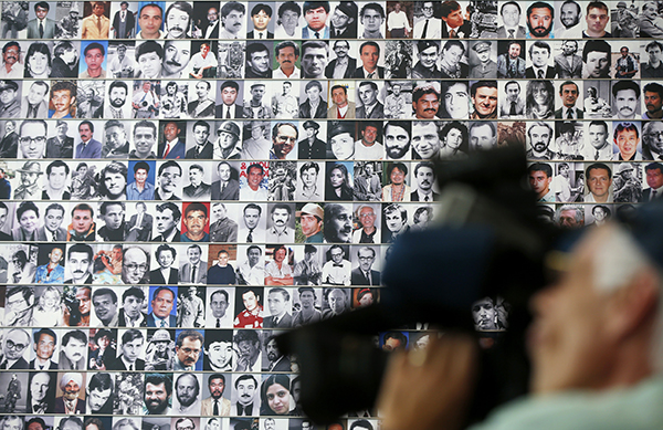 Photographs of journalists killed in action feature on a memorial wall at Washington DC's Newseum. Freelancers and news outlets are rethinking safety in response to increased risk. (AP/Charles Dharapak)