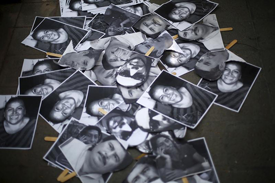 Images of murdered journalists are seen at this protest in front of the government of Veracruz building in Mexico City, February 11, 2016. (Reuters/Edgard Garrido)