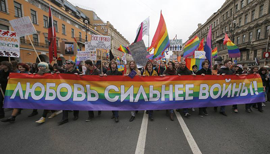 """Protesters in St. Petersburg hold a banner reading """"Love is stronger than war,"""" May 1, 2014. The mayor of the nearby border city of Svetogorsk's assertion that there were no homosexuals in his town drew reporters seeking follow-up stories. (Reuters/Alexander Demianchuck)"""