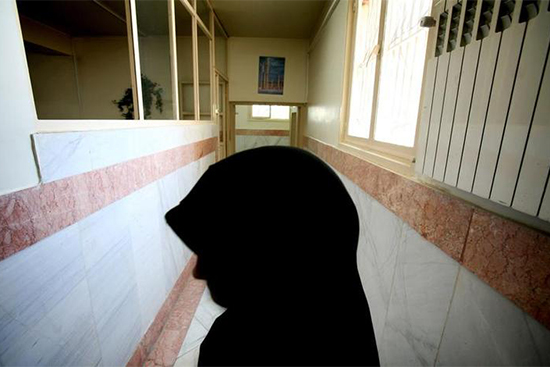 A guard stands in a hallway in the women's section of Tehran's Evin Prison, June 13, 2006. Journalist and activist Hengameh Shahidi was transferred to the prison last week. (Reuters/Morteza Nikoubazi)