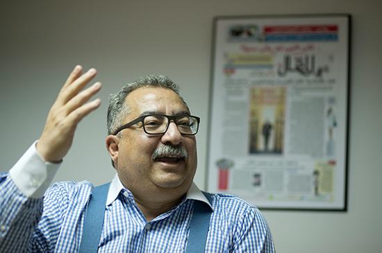 Ibrahim Eissa, editor of Al-Maqal newspaper, gestures in his office in Cairo, November 10, 2016. (AP/Amr Nabil)