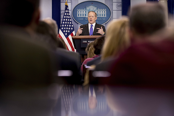 White House press secretary Sean Spicer talks to the media during the daily briefing. President Trump and his administration have accused critical outlets of being fake news. (AP Photo/Andrew Harnik)