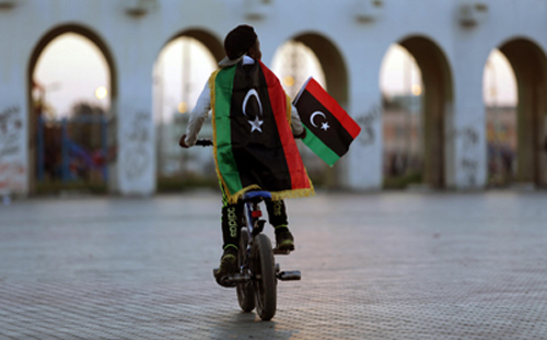 A boy celebrates the sixth anniversary of the Libyan revolution in Benghazi on February 17, 2017. Libya is divided between two rival governments. (Reuters/Esam Omran Al-Fetori)