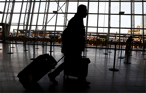 A traveler arrives at New York's JFK airport. Suggestions by the Homeland Security Secretary that passengers be asked for social media passwords would impact journalists. (Reuters/Brendan McDermid)