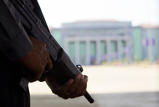 Police stand guard outside the National Reconciliation and Peace Center in Naypyitaw, March 1, 2017. (AP Photo/Aung Shine Oo)