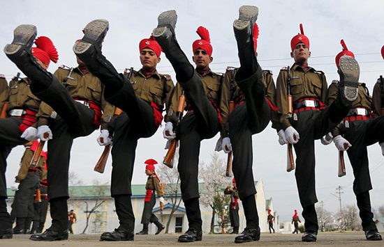 Indian Army recruits in ceremonial uniform graduate from a 49-week training program in Rangreth, Jammu and Kashmir, March 5, 2016. Journalist Poonam Argawal faces charges for an undercover investigative report alleging senior officers near Mumbai improperly ordered subordinates to carry out personal errands on their behalf.