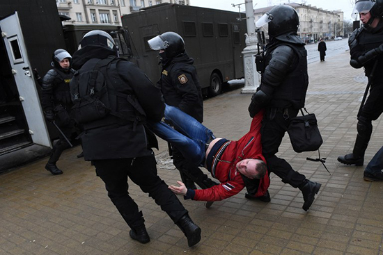 Belarusian police detain a man at a March 25, 2017, protest in Minsk. (AFP/Vasily Maximov)