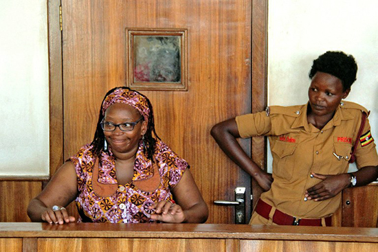 Academic Stella Nyanzi defends herself in a Kampala court on charges stemming from her critical remarks online about Ugandan President Yoweri Museveni, April 10, 2017. Journalist Gertrude Uwitware has faced threats, abduction, and assault for her writing in support of Nyanzi. (AFP/Gael Grilhot)