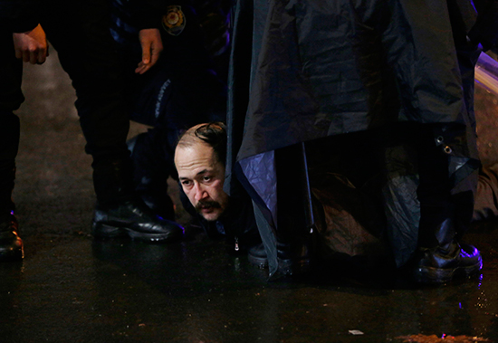 Police detain a protester outside the Supreme Board of Elections in Ankara, April 16, 2017. (AP/Burhan Ozbilici)