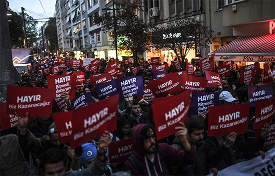 Supporters of the 'No' campaign in Turkey's referendum protest in Istanbul on April 17. At least three journalists covering opposition to the vote have been detained. (AFP/Bulent Kilic)