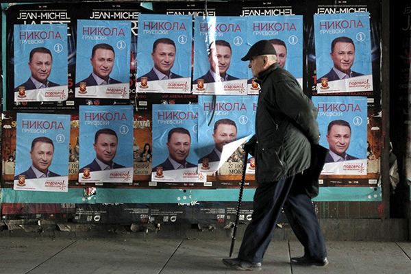 Election posters for Nikola Gruevski, of Macedonia's VMRO-DPMNE party, in Skopje in December. Gruevski, who is struggling to form a coalition government, accuses critical media of being foreign mercenaries. (AP/Boris Grdanoski)