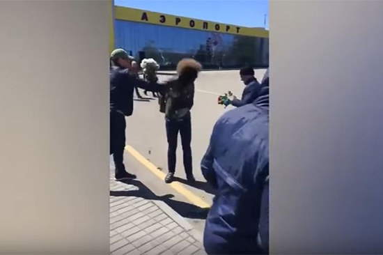 A still image created from a video shows an unknown assailant throwing an antiseptic at Russian blogger Ilya Varlamov at Stavropol airport, April 26, 2017.