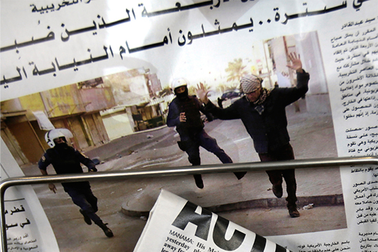 Bahraini newspapers feature front-page stories on the arrest of four American journalists, with one photo purportedly showing one of the journalists with hands raised while being arrested, in Manama, Bahrain, February 16, 2016. The journalists were quickly released. (AP/Hasan Jamali)