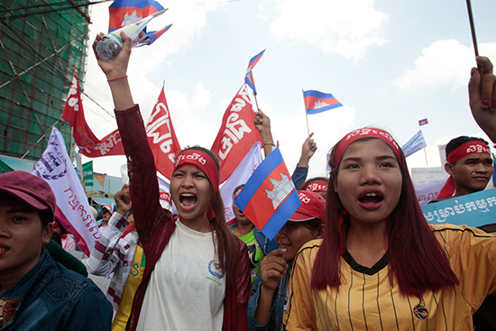 Garment workers protest for higher wages near Cambodia's National Assembly in Phnom Penh, May 1, 2017. As the government clamps down on opposition ahead of local elections scheduled for June, a Radio Free Asia journalist has fled the country upon learning of a court summons. (AP/Heng Sinith)