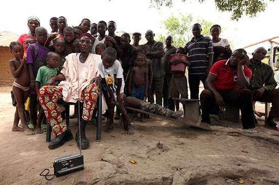 In this May 10, 2016, file photo, residents of the rural Nigerian village Agatu listen to a radio news broadcast. (AFP/Getty/Emmanuel Arewa)